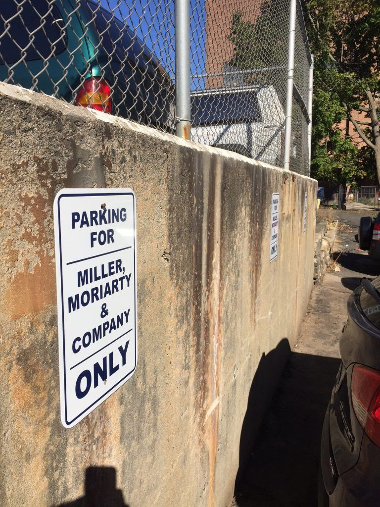 Designated parking lot signs in New Britain CT